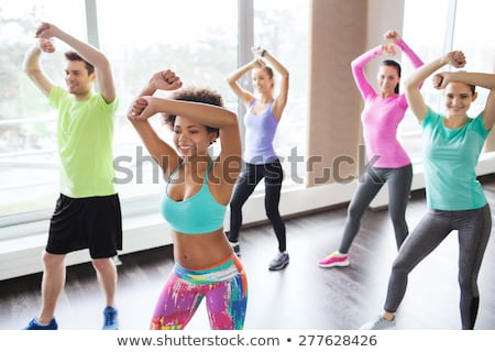 Group of young people having dance class in gym Stock photo © Kzenon