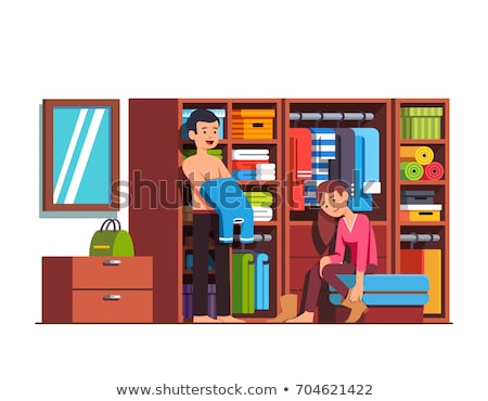 a young couple getting dressed in the changing room stock photo © spectral