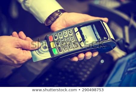 Közelkép üzletember tart fizetés hitelkártya fehér Stock fotó © deandrobot