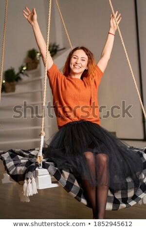 redheaded beautiful slim girl in her living room Stock photo © Giulio_Fornasar