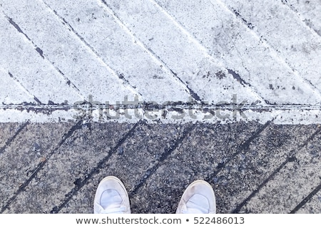 Pair of sneakers on pavement with digital glitch effect Stock photo © stevanovicigor