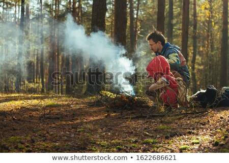 A boy making a campfire Stock photo © bluering