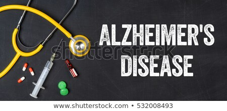 Stethoscope and pharmaceuticals on a blackboard - Alzheimer's di Stock photo © Zerbor