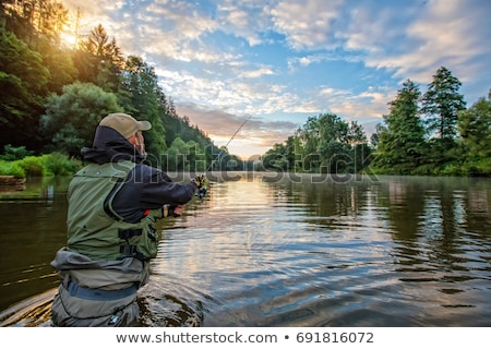Man fishing on sunset  Stock photo © homydesign