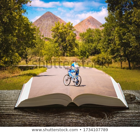 Book with cyclist riding on the road Stock photo © bluering
