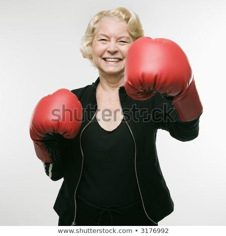 Sorridente mulher da aptidão luvas de boxe em pé Foto stock © deandrobot