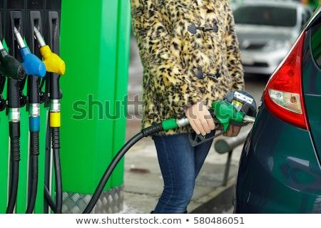 Kobieta benzyny samochodu stacji benzynowej zimą Zdjęcia stock © vlad_star