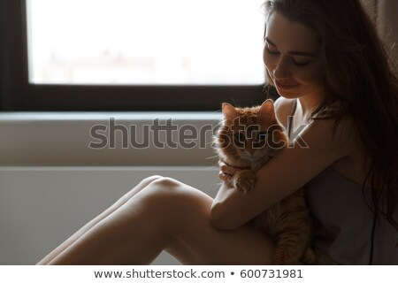 Cropped image of woman in nightie with cat Stock photo © deandrobot