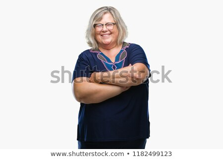 Laughing mature woman wearing glasses posing isolated Stock photo © deandrobot
