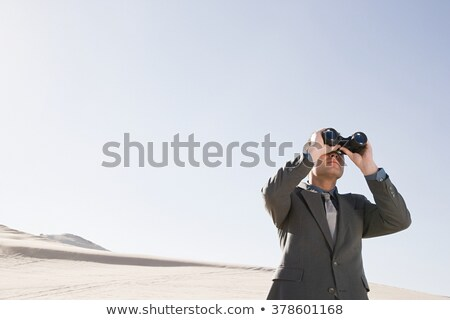 lookout businessman with binoculars stock photo © studiostoks