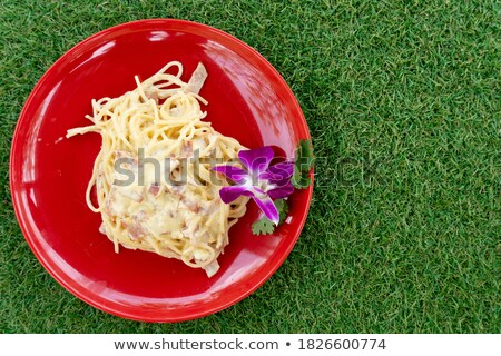 Artificially colored pasta in plates Stock photo © erierika