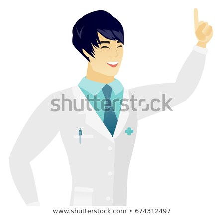 Asian doctor pointing with his forefinger Stock photo © RAStudio