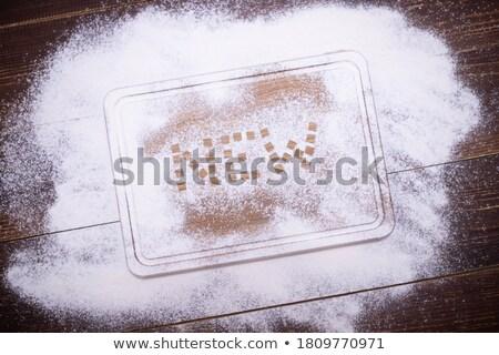 The word bakery written on sprinkled flour Stock photo © wavebreak_media