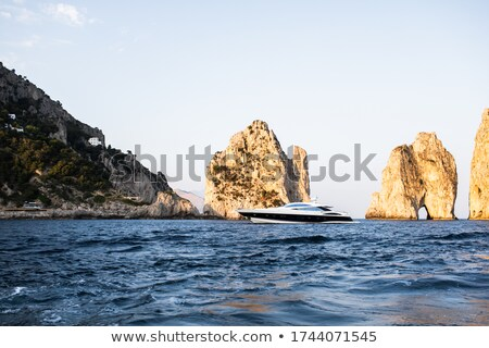 Woman on boat, with coastline visible Stock photo © IS2