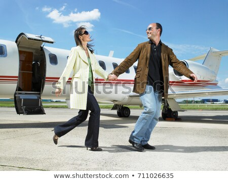 Happy couple running out of private jet. Stock photo © IS2