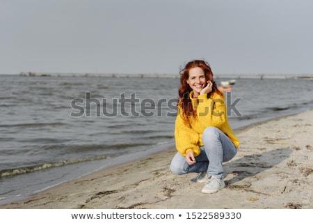 fiatal · lány · mosolyog · guggol · lány · állat · Európa - stock fotó © is2