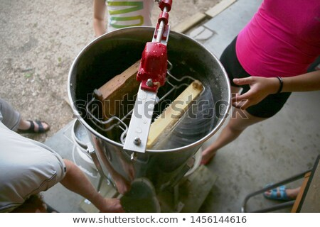 Honey extractor with honeycomb wax with honey frame Stock photo © FreeProd