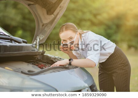 Pretty, young woman by the roadside after her car has broken down Stock photo © lightpoet