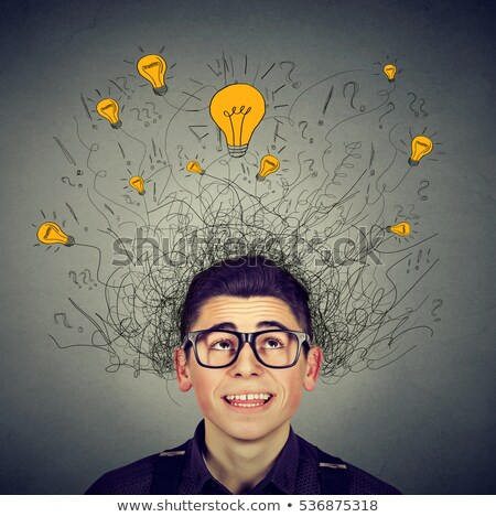 Excited man looking up at many ideas light bulbs above head  Stock photo © ichiosea