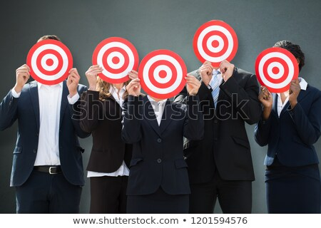 Group Of Businesspeople Hiding Their Faces Behind Dartboard Stock photo © AndreyPopov