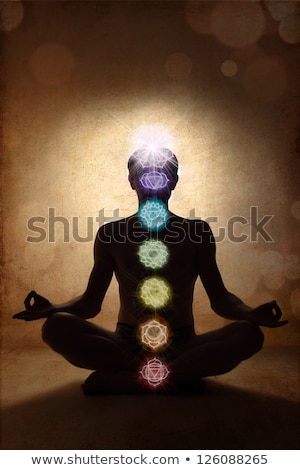 Stock photo: Yoga man in lotus pose with chakra symbols