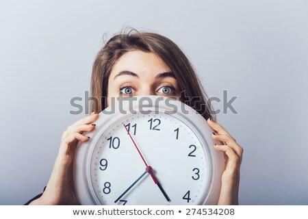 Attractive shocked woman with clocks Stock photo © Traimak