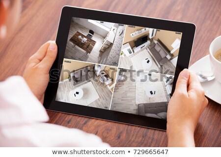 Elevated View Of A Girl Using Digital Tablet Stock photo © AndreyPopov
