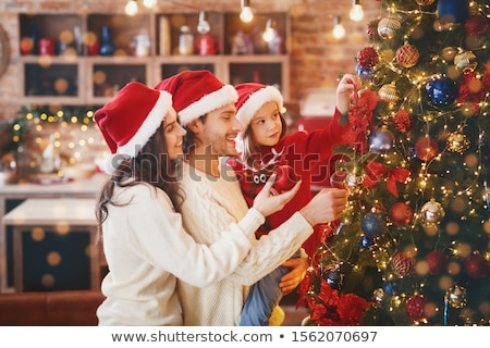 Happy Young Family Getting Ready to Xmas Eve Stock photo © robuart