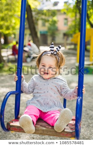 Cute adorabile giocare swing parco Foto d'archivio © Lopolo