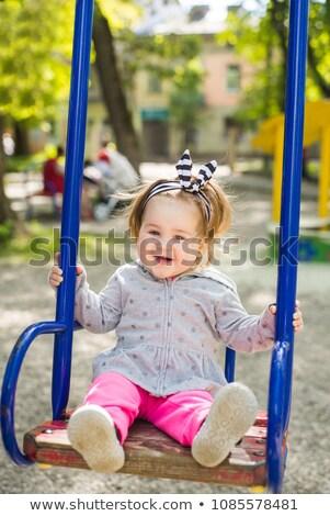 Cute adorable jugando swing parque Foto stock © Lopolo