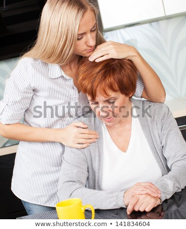 Young Adult Woman Consoles Sad Senior Adult Female Stock photo © feverpitch
