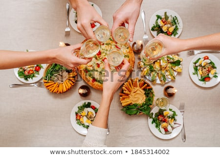 Clinking over served table Stock photo © pressmaster