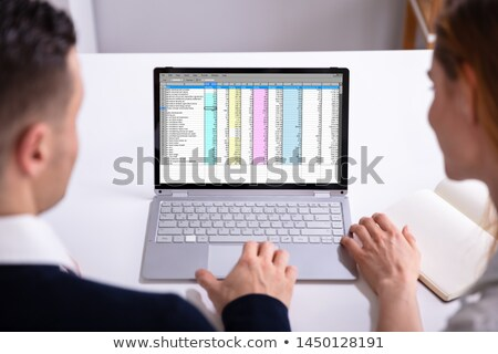 Businesspeople Checking Spreadsheet On Laptop Screen Stock photo © AndreyPopov