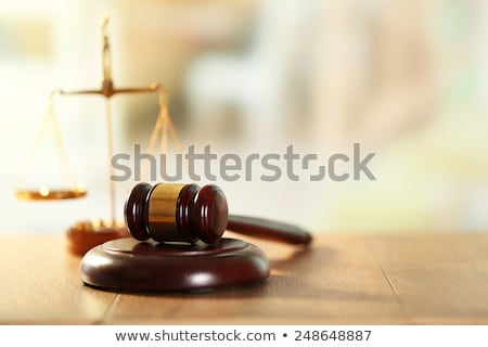 close up of scales of justice and gavel on wooden table in a cou stock photo © freedomz
