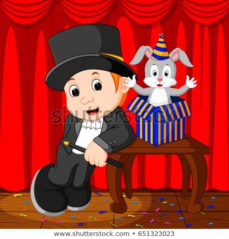 Mágico menino truque de mágica coelhinho da páscoa colorido ovos Foto stock © ilona75