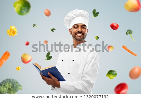 happy male indian chef in toque over vegetables Stock photo © dolgachov