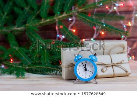 Idő asztal új év fekete ébresztőóra fenyőfa Stock fotó © Illia