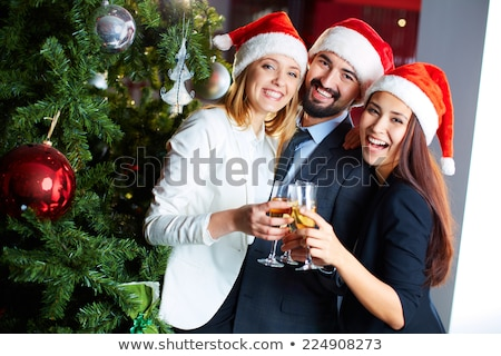Happy young businesspeople toasting for Christmas with flutes of champagne Stock photo © pressmaster