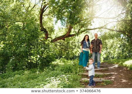 A Beautiful 30 years old pregnant woman outdoor Stock photo © Lopolo