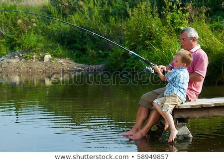мальчика деда удочка реке семьи поколение Сток-фото © dolgachov