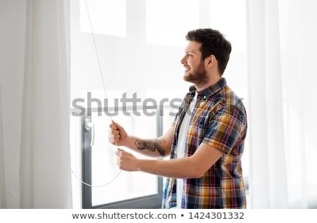 Férfi nyitás vak ablak otthon emberek Stock fotó © dolgachov