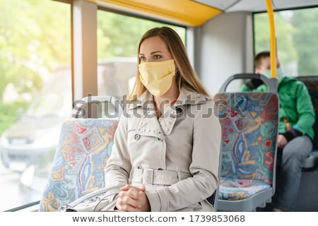Woman using public transport during covid-19 crisis Stock photo © Kzenon