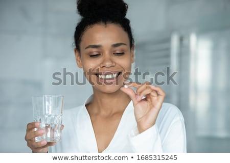 Vitaminen mineralen pil capsules vrouw Stockfoto © Maridav