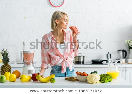 Beautiful woman drinks healthy orange fruit juice stock photo © darrinhenry