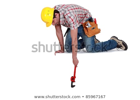 Worker reaching down with a wrench Stock photo © photography33