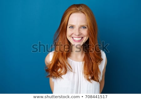 Portrait of a young redhead woman with blue eyes Stock photo © photography33