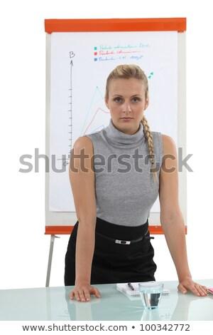 Tolakodó szőke nő flipchart papír öltöny Stock fotó © photography33