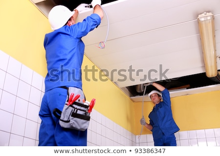 Two electrician inspection ceiling panels Stock photo © photography33