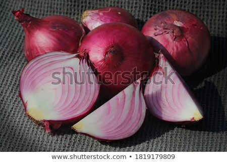 Quarter of a Red Onion on Black Stock photo © ildi