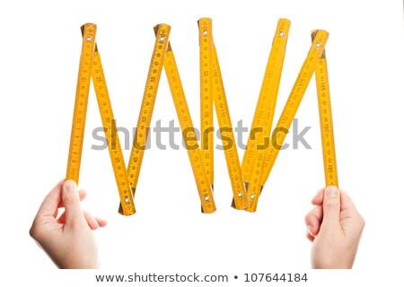 Hands Holding Wooden Folding Ruler Сток-фото © Taigi